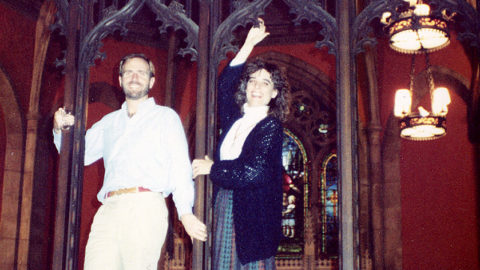 photo of James and Cherry Rhodes on the rood screen, pre-renovation
