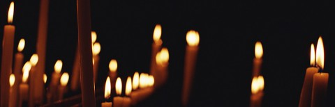 photo of lit candles