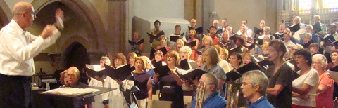photo of Canterbury and Coventry choirs in rehearsal